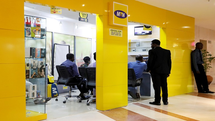 Customers are pictured inside an MTN dealer shop