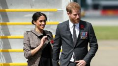 Britain's Prince Harry (R) and his wife Meghan (L), the Duchess of Sussex.