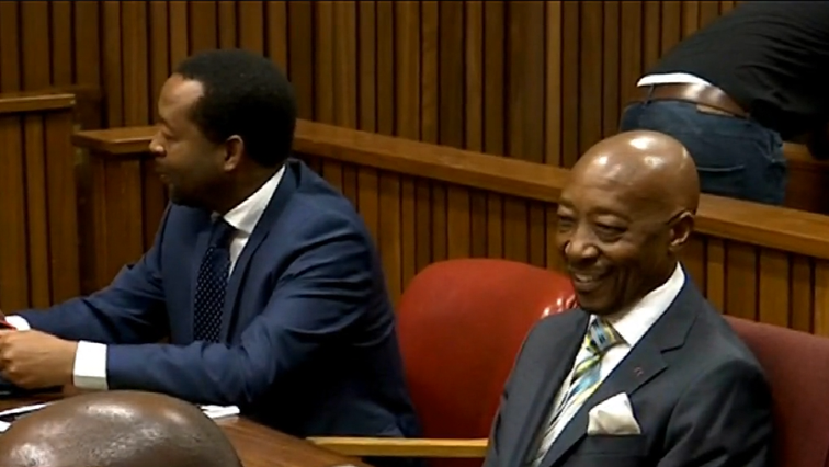 Tom Moyane smiling in court