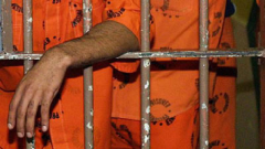 Prisoners behind bars.