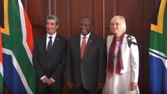 Ramaphosa standing with 2 ambassadors