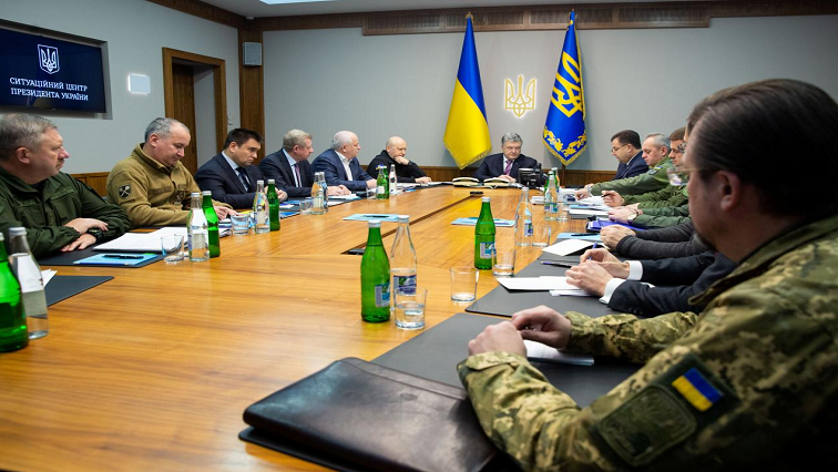 President Petro Poroshenko having a meeting with members of the army.