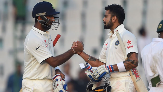 SABC News Virat Kohli and Cheteshwar Pujara AFP