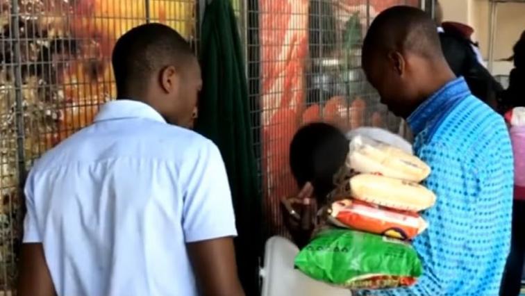 Two men grocery shopping