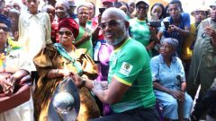 Chairman Khurishi Mphahlele holding the trophy