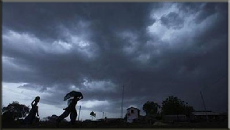 People running for shelter in a thunderstorm.
