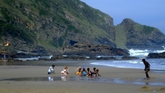 Children playing by the beach