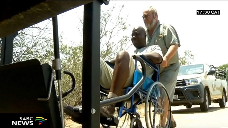 A man pushed in Wheelchair