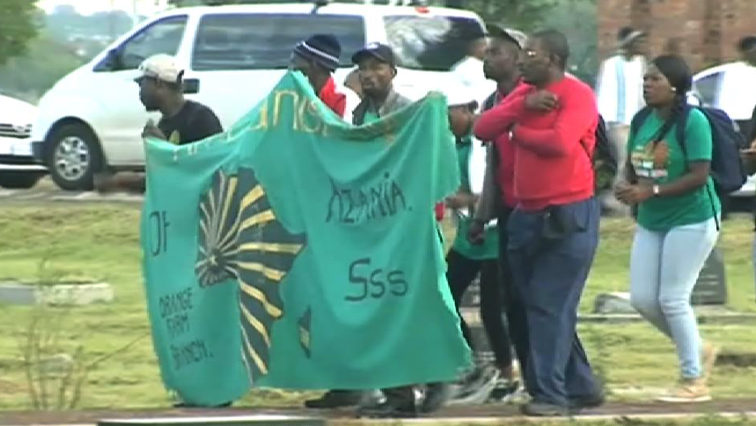 PAC members carrying a banner