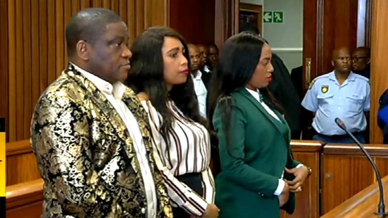Three people standing in court