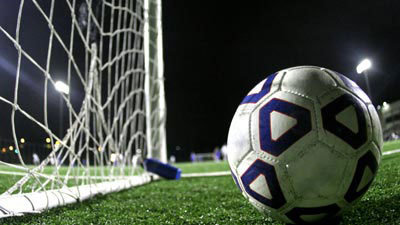 Soccer ball next to a net