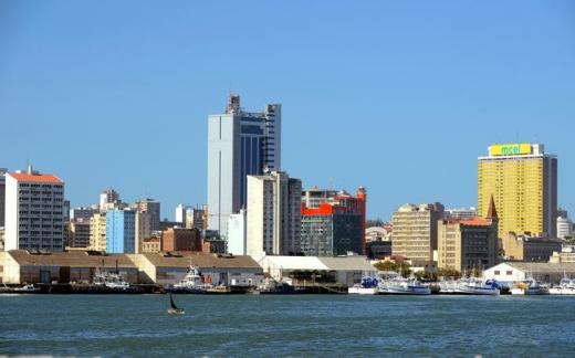 Fishing boats sit beneath the skyline of Mozambique's capital Maputo.