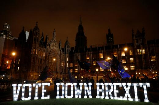 Anti-Brexit protesters are seen outside the Houses of Parliament in London, December 10, 2018.