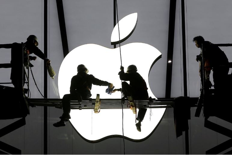 Workers cleaning the Apple store icon and window