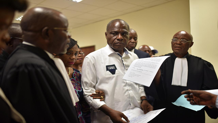 Martin Fayulu and his legal team in court