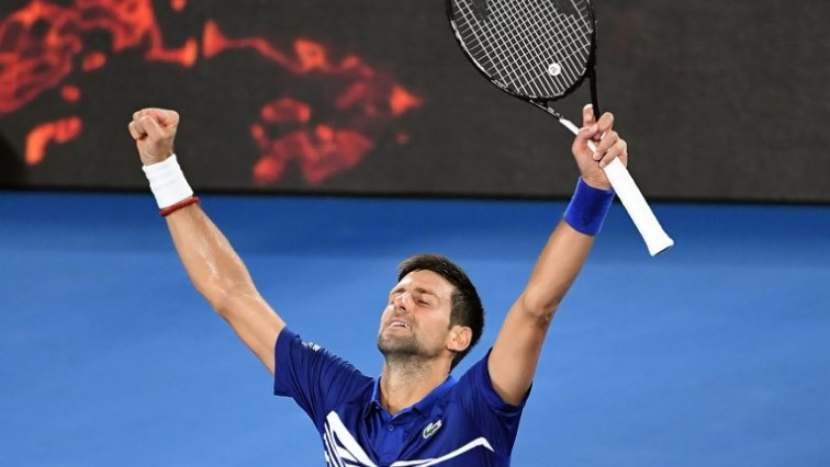 Novak  Djokovic celebrating victory.