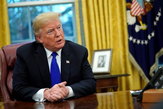 US President Donald Trump sits for an exclusive interview with Reuters journalists in the Oval Office at the White House, December 11, 2018