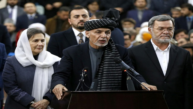 Afghanistan's President Ashraf Ghani speaks to the media after arriving to register as a candidate for the upcoming presidential election at the Afghanistan's Independent Election Commission (IEC) in Kabul