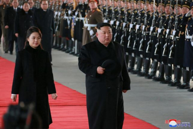 North Korean Leader Kim Jong Un and his wife Ri Sol Ju inspect an honour guard before leaving Pyongyang for for a visit to China.