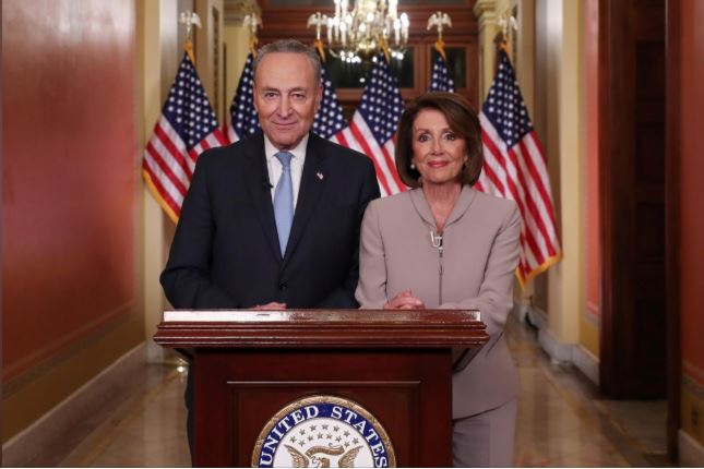 US Speaker of the House Nancy Pelosi and Senate Minority Leader Chuck Schumer pose for photographers after concluding their joint response, to President Trump's prime time address, on Capitol Hill in Washington.