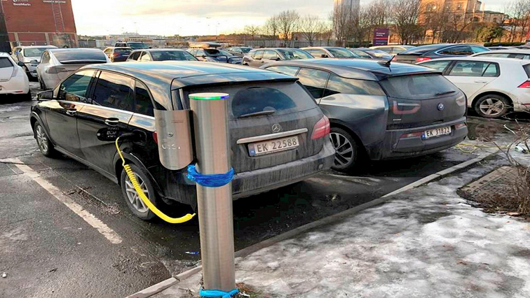 An electric car being fuelled