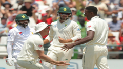 Kagiso Rabada celebrates the wicket of Pakistan's Azhar Ali with team mates