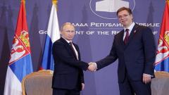 Russian President Vladimir Putin shakes hands with Serbian President Aleksandar Vucic