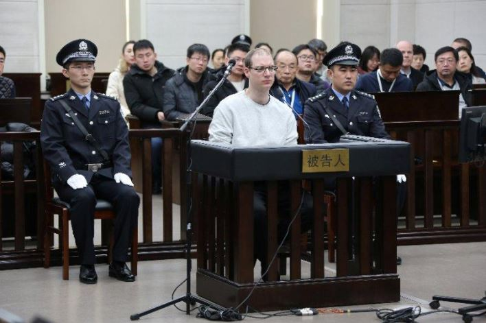 Canadian Robert Lloyd Schellenberg appears in court for a retrial of his drug smuggling case in Dalian