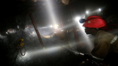 Mineworkers from Sibanye Gold's Masimthembe shaft operate a drill