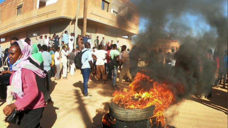 Sudanese demonstrators burn tyres as they participate in anti-government protests in Omdurman, Khartoum, Sudan.