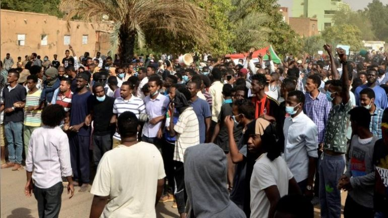 Sudanese demonstrators gather as they participate in anti-government protests in Khartoum, Sudan.
