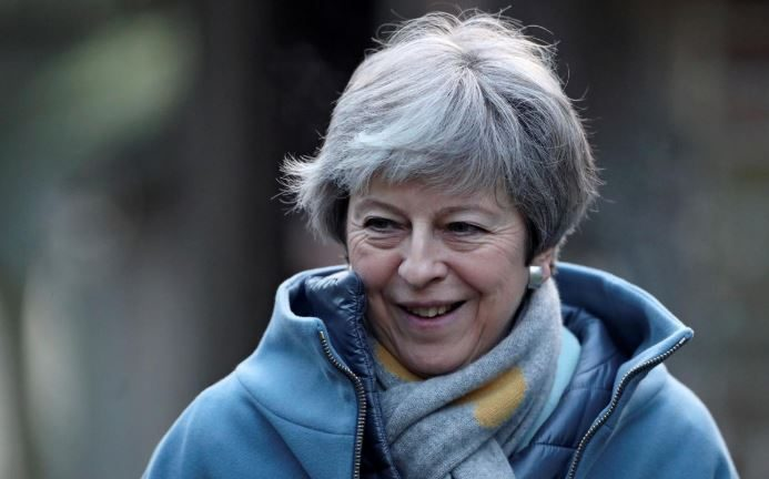 Britain's Prime Minister Theresa May smiling