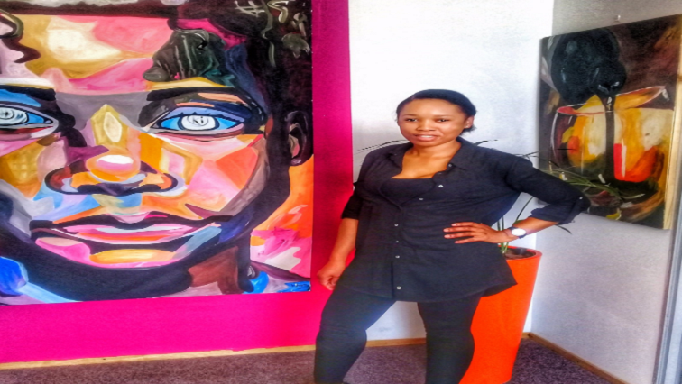 Tumi Tlhabi next to artwork