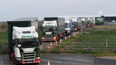 "Lorries leave disused Manston Airport to attend a test drive to the Port of Dover during a trial of how road will cope in case of a ""no-deal"" Brexit."