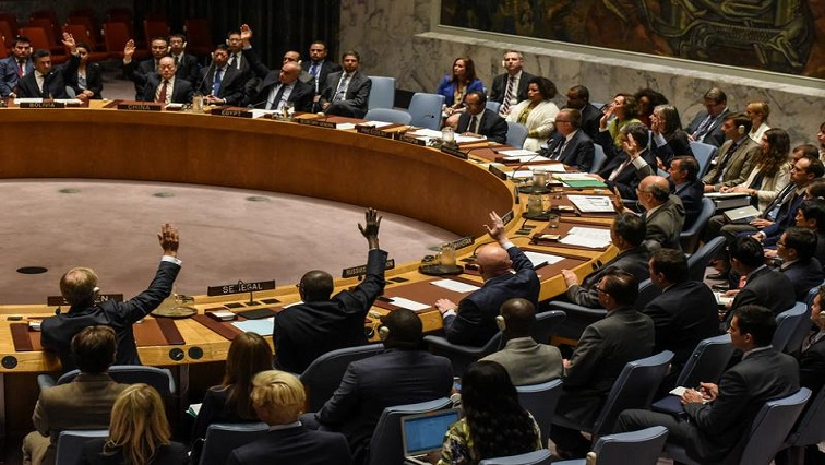 FILE PHOTO: Ambassadors to the UN vote during a United Nations Security Council meeting on North Korea in New York City