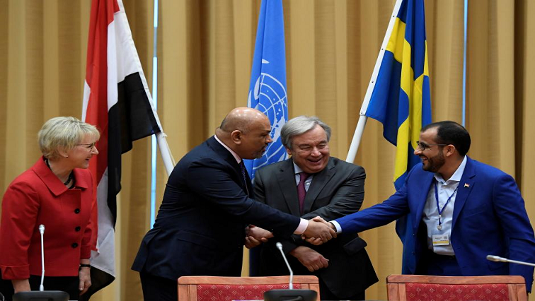 Head of Houthi delegation Mohammed Abdul-Salam and Yemeni Foreign Minister Khaled al-Yaman shake hands next to United Nations Secretary General Antonio Guterres and Swedish Foreign Minister Margot Wallstrom