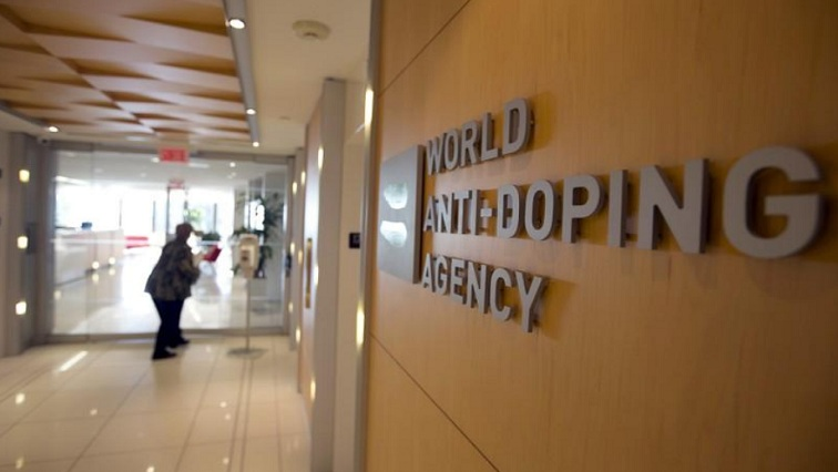 A woman walks into the head office of the World Anti-Doping Agency (WADA) in Montreal, Quebec, Canada November 9, 2015.