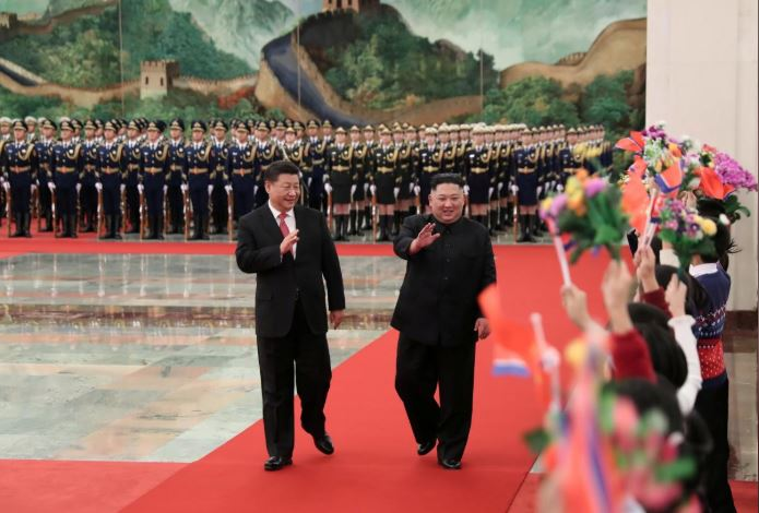 Chinese President Xi Jinping holds a welcoming ceremony for North Korean leader Kim Jong Un before their talks at the Great Hall of the People in Beijing.