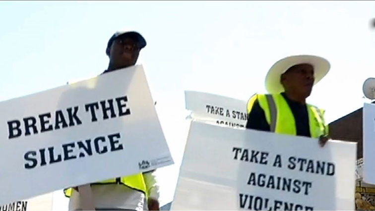 Two men with placards