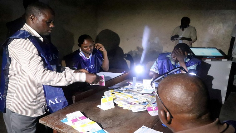 Agents of Congo's National Independent Electoral Commission count casted ballot papers after election at a polling station