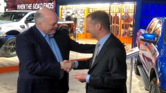 The President and CEO of Ford Motor Company Jim Hackett, shakes hands with Volkswagen CEO Herbert Diess.