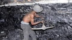 A miner mining coal