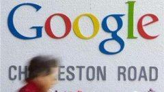 A person walks past a Google logo.