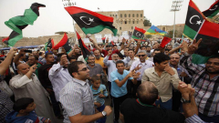 Libyans carrying the Libya flag