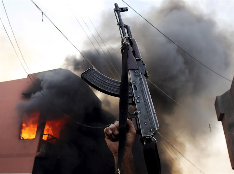 Guns in smoke filled air