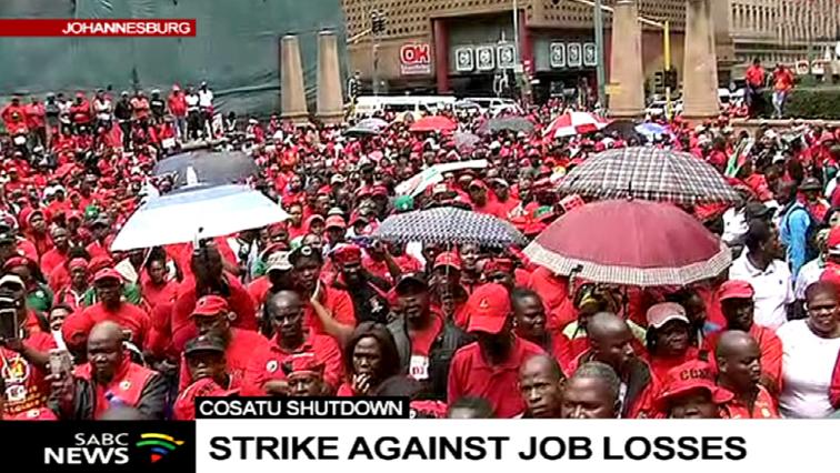 Cosatu members striking against job losses.