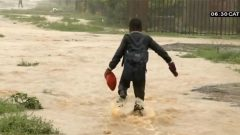 Boy walking through flooded path