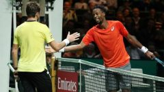 France's Gael Monfils shakes hands with Switzerland's Stan Wawrinka after winning their Final match.