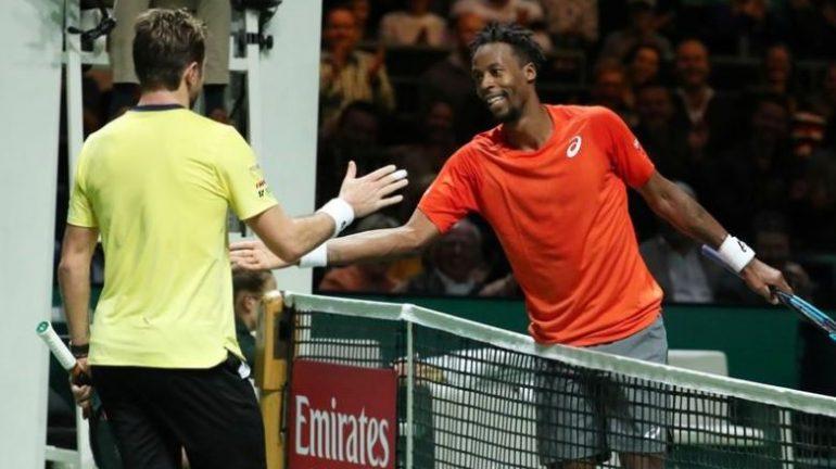 France's Gael Monfils shakes hands with Switzerland's Stan Wawrinka after winning their Final match.