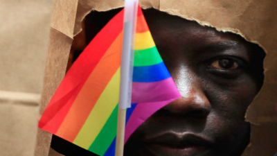 Man with colourful flag